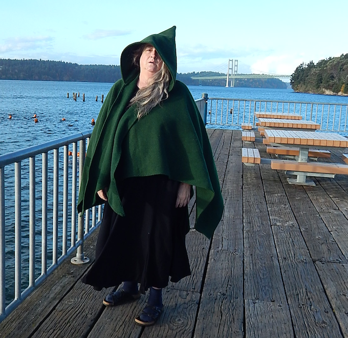 Heavy wool cape on maker, Narrows Bridge in background