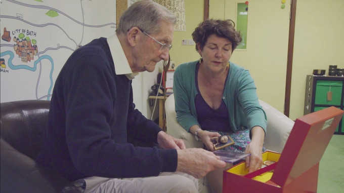 David with his daughter putting his box together
