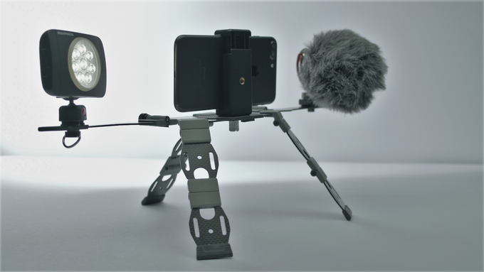 Inuk with smart phone, light and microphone