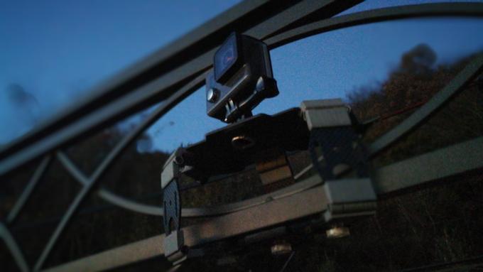 Inuk with GoPro on a metal gazebo