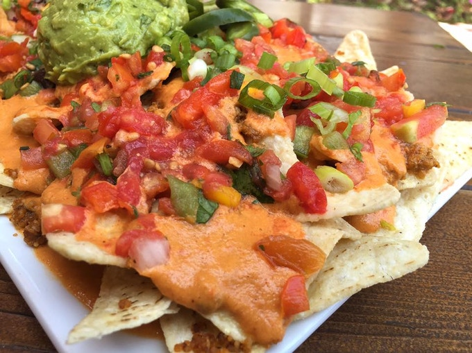 "Nachos with house sunflower nacho ""cheese"", house sunflower chorizo, cashew sour cream, fresh guacamole & pico de gallo. Oh yeah!"