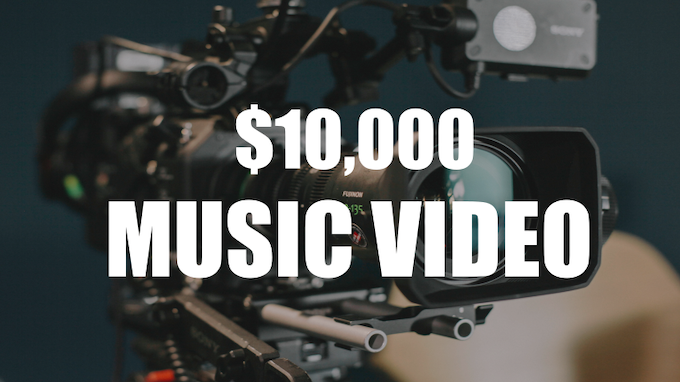 Shooting for the stars here folks. At 10k, I'll be able to hire my friend Josh Herum to do a full production music video, including shots with a full backing band.