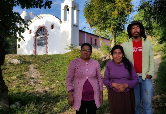 Day 303 Oaxaca, Mexico. My wonderful hosts posing in front of their house and church. By modern means we really didn't get that far in these 273 days! That was EXACTLY the point.