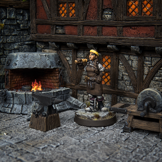 Erika working the smithy. Accessories by Zealot Miniatures and buildings by Tabletop-World.