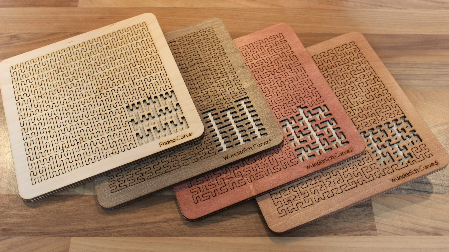 Four more fiendishly complicated tray puzzles based upon space filling fractal curves.