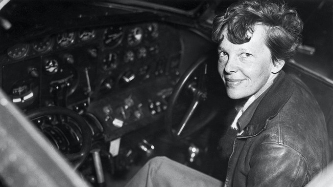 Amelia Earhart at the controls of her Lockheed