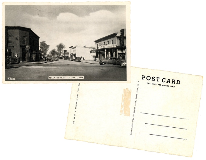 Original 1940s black + white postcard of Main Street. For a $250 pledge, you'll receive this rare postcard plus TWO signed copies of the book.