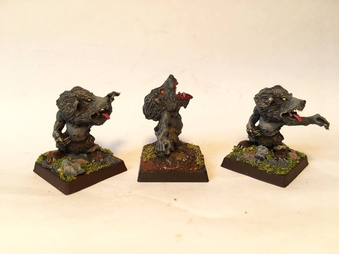 Norse Dwarf Ulfenwere in Were form. Two different versions. The right mini has its are re positioned on the left.