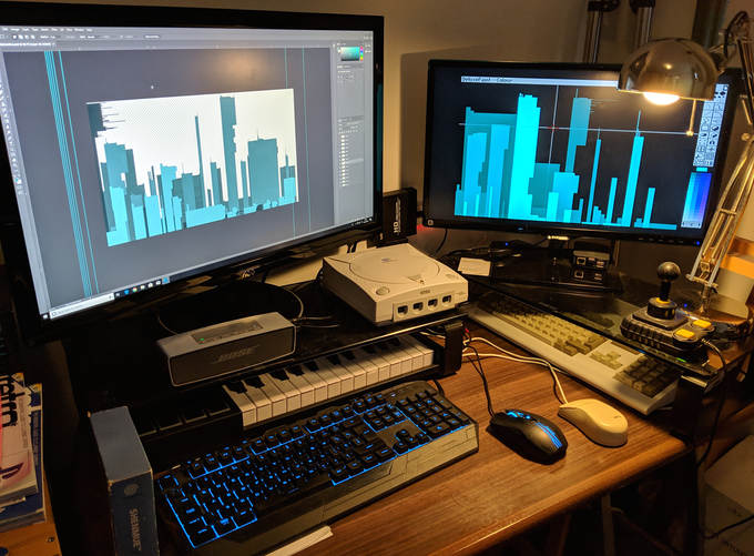 On the left screen we have the city scape on Photoshop, and the right screen is my Amiga running Delux Paint