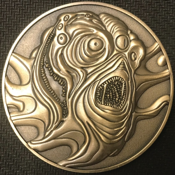 Front of Yellow Sign coin - plated in antique gold