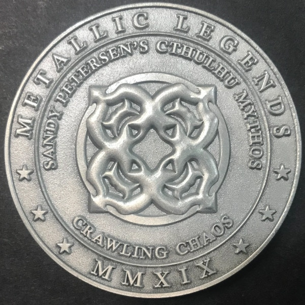 Back of Crawling Chaos coin - plated in antique silver