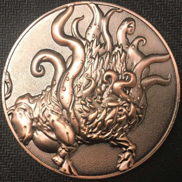 Front of Black Goat coin - plated in antique copper