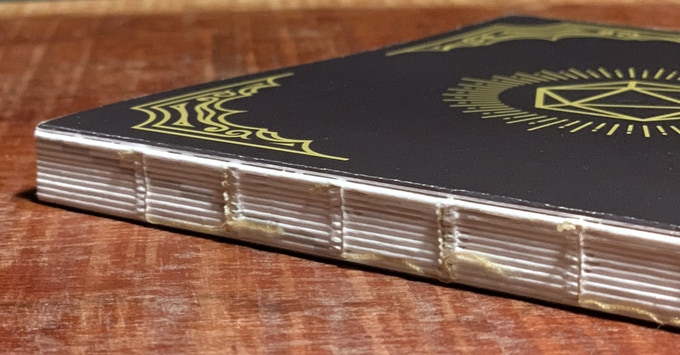 Archival-quality binding to last across many campaigns (original HeroBook cover design shown)