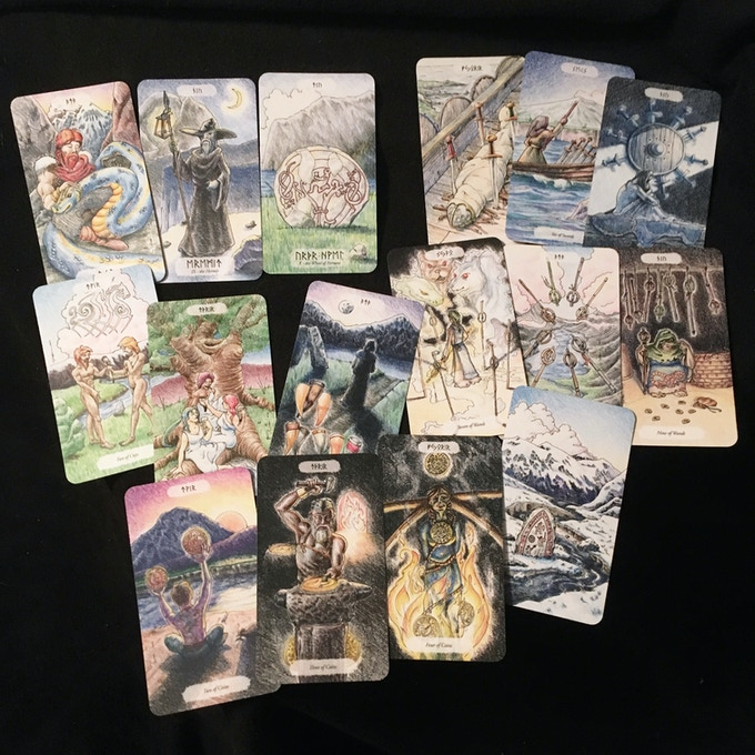 A cross-section of major and minor arcana, which is a good representation of the art throughout the deck.