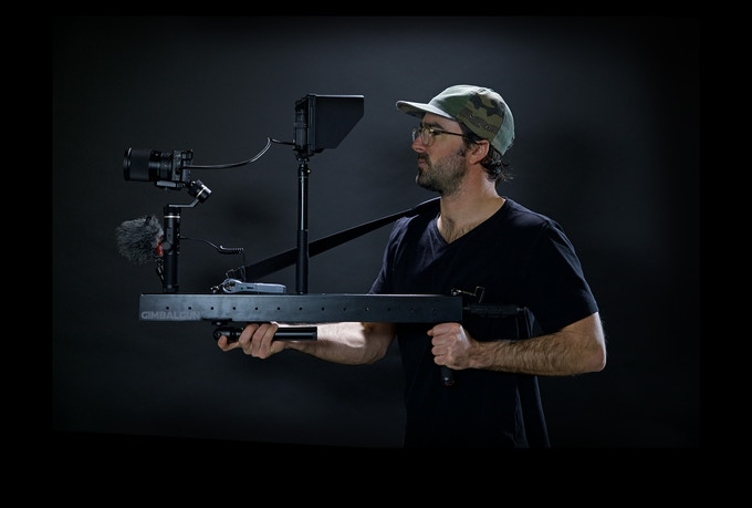 """""""Sniper Mode"""" Raise the GimbalGun™ up to eye level for a perfect view of the monitor. You may also move the monitor mount forward or back on the GimbalGun™ depending on personal preference."""