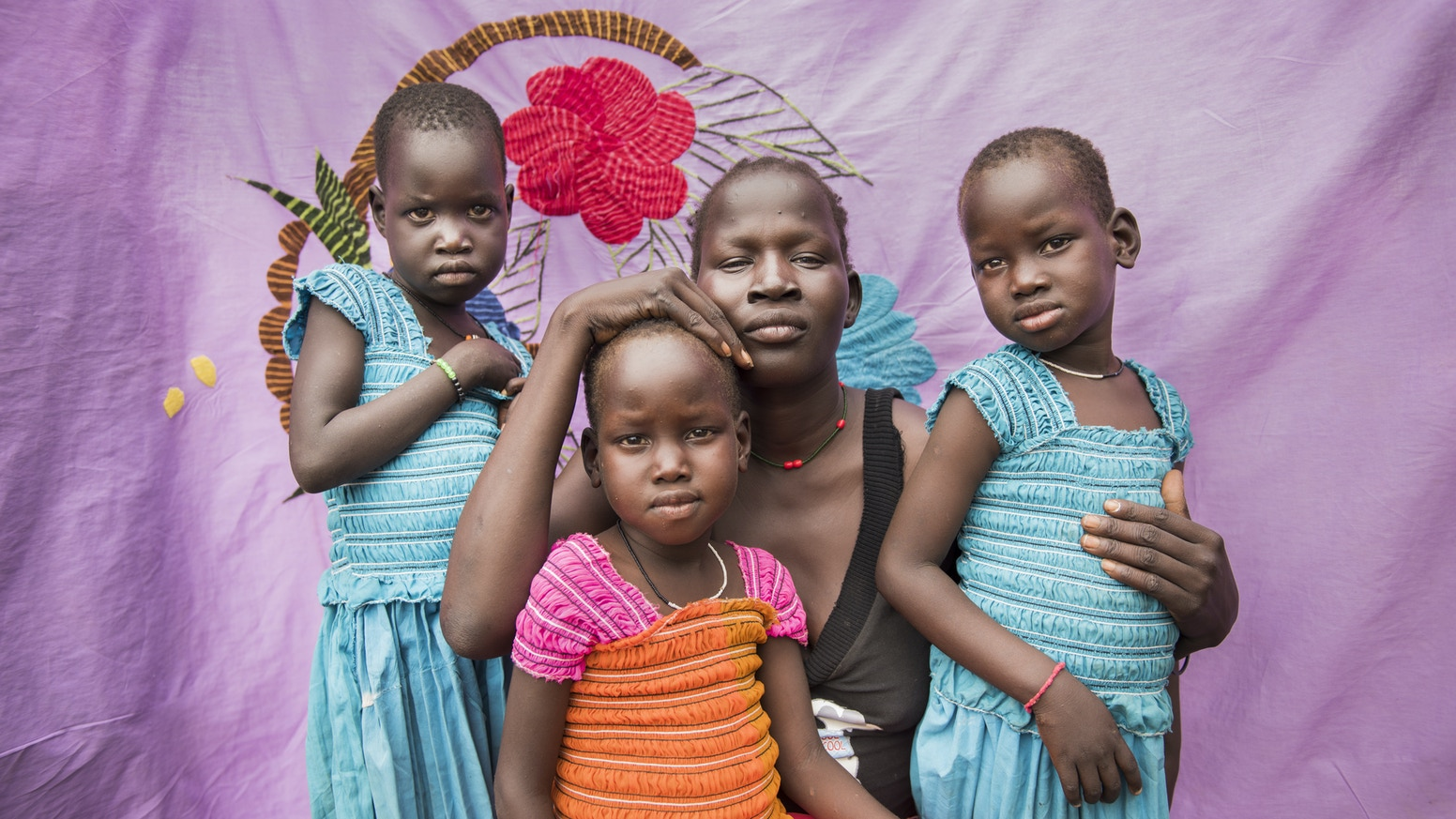 In a remote refugee camp, South Sudanese women keep tradition alive by hand-embroidering sheets and pillowcases.