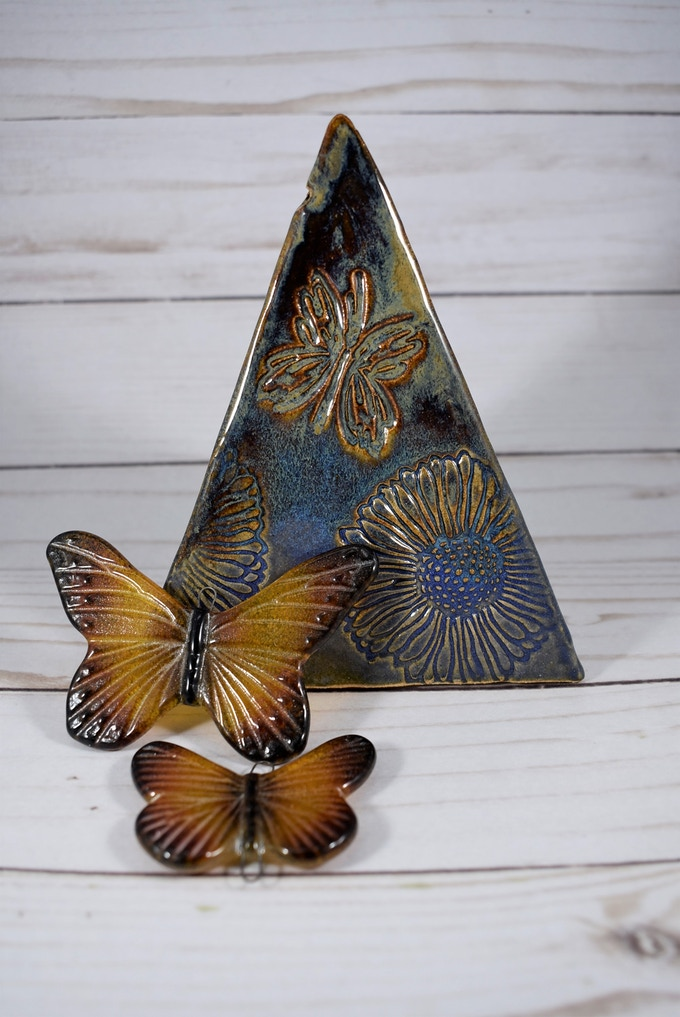 Stoneware wind bell, with cast glass butterfly wind sails