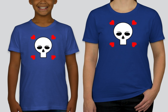 """Now you can rock out with the official """"Skull and Hearts"""" PUNK TACO  Logo T-Shirt just like everyone's favorite lovable alien taco. This beauty comes in Women's, Men's and Children's styles and is available in any size. Pledge $35 to get yours and wear it with pride."""