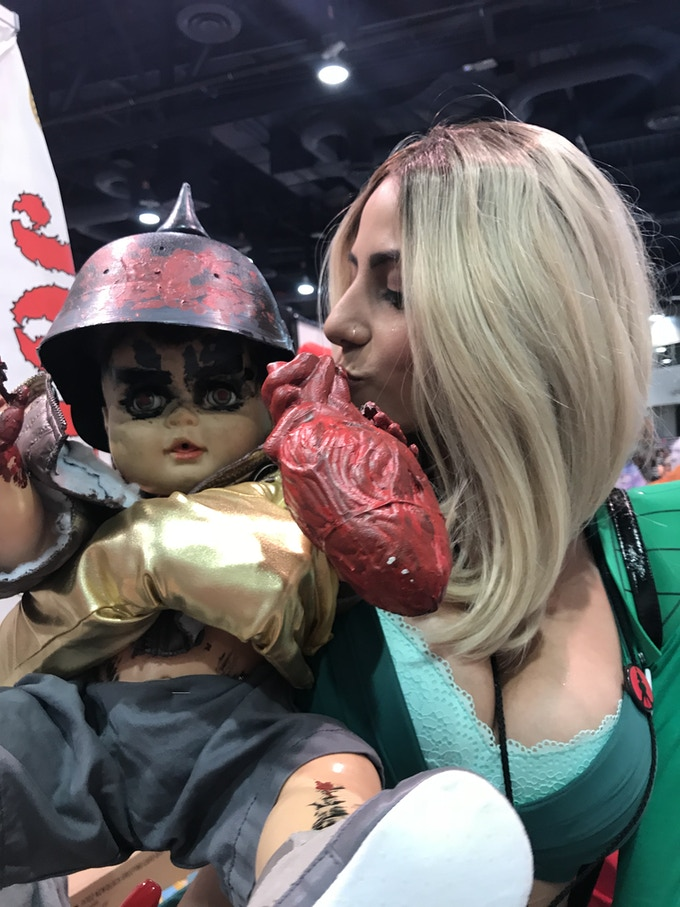 Joey cosplayer with the original Baby Badass doll.