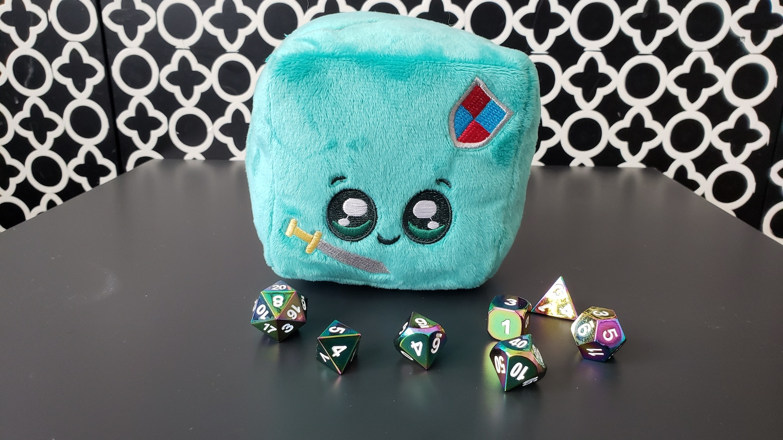 Lord Gelbert Jellington is a Gelatinous Plush Dice Pouch that can keep your favorite set of polyhedral dice safe and cozy.
