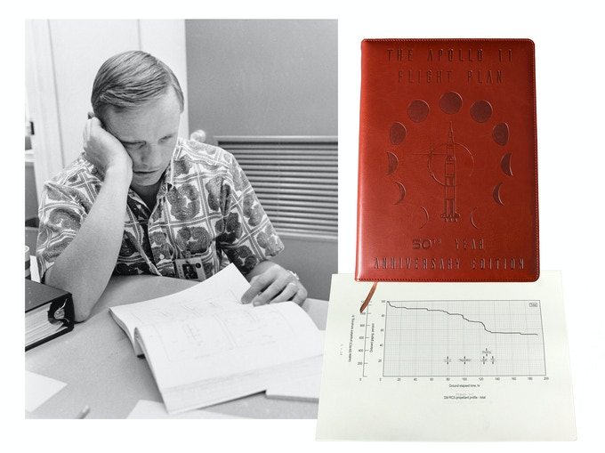 Neil Armstrong Studies his copy of the Apollo 11 Flight Plan.