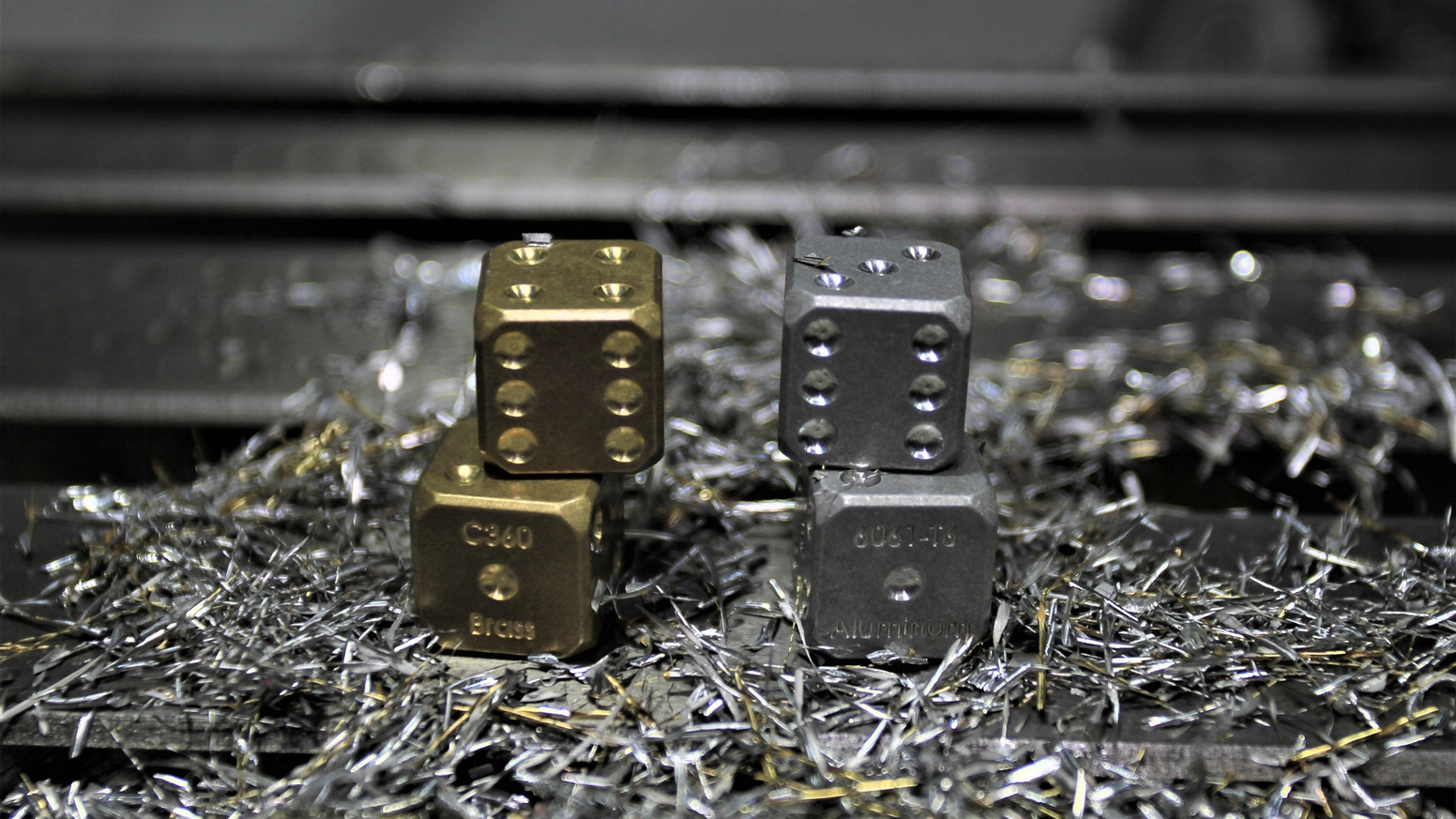 Dice that are precision CNC machined from metal alloys used in engineering