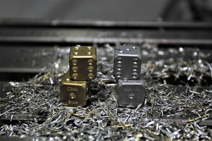 Dice with or without the metal alloy engraving