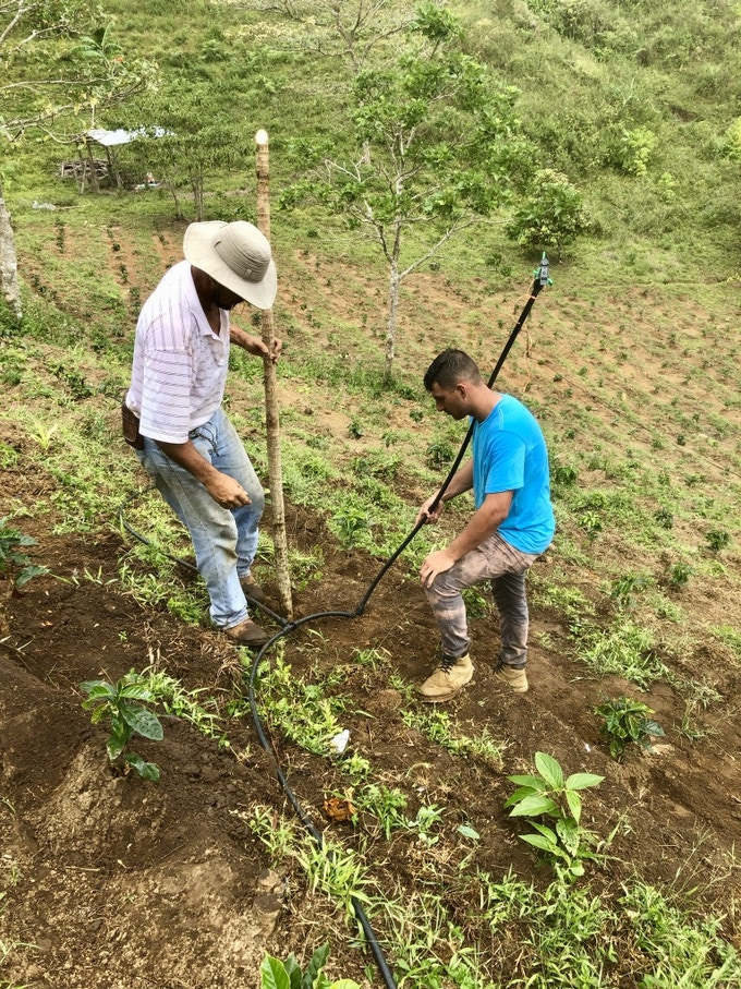 Farm Manager Mainor Salazar with his son Yunior repairing the old irrigation system. We will install a more efficient drip irrigation system. In many parts of Costa Rica, water is 'gold'.