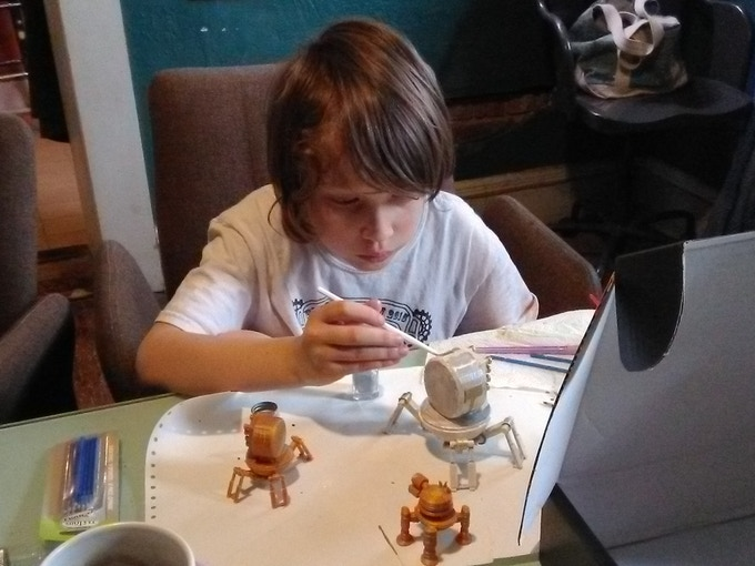 Seamus painting one of his bot concepts.