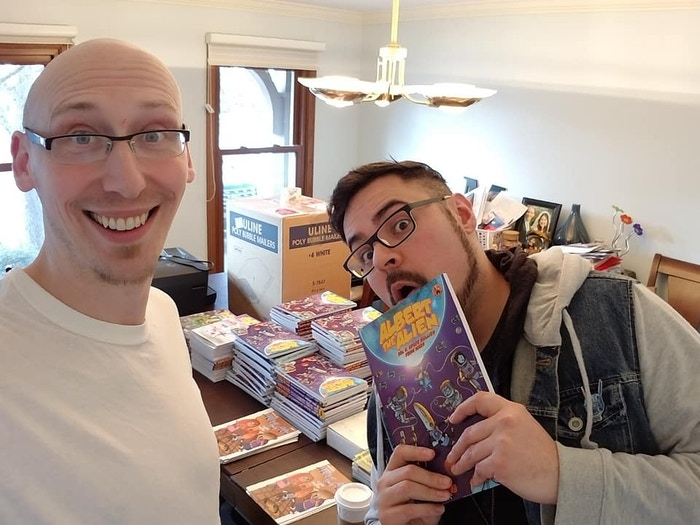 Trevor and Gabo - and the stacks of comics we signed!