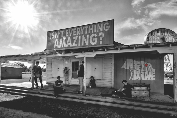 """Isn't Everything Amazing?"" poster signed by the band!"