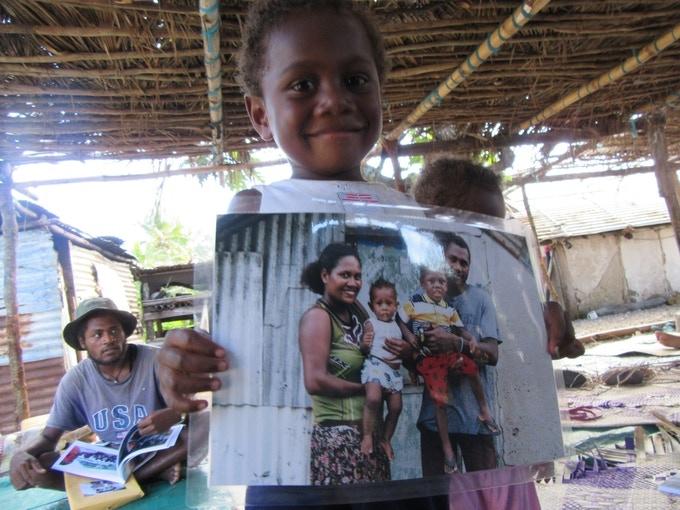 Book and Portrait Delivery Last Year on Makira, Vanuatu