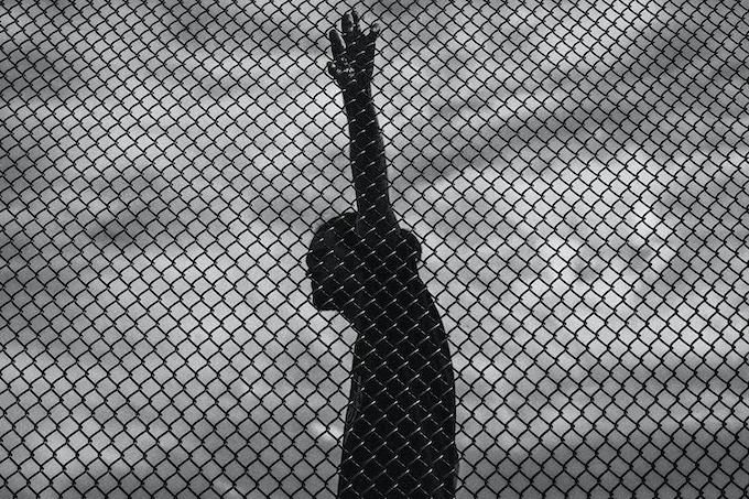 Dalton gripping a chain link fence. Cedar Rapids, Iowa. 2016