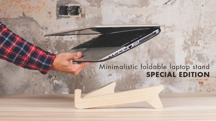 A minimalistic, foldable laptop stand designed so that you can easily  take it with you to use your laptop anywhere you want with the greatest  comfort and without bad postures.