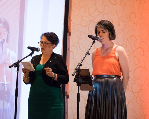 Shidan and Shadi performing at a conference