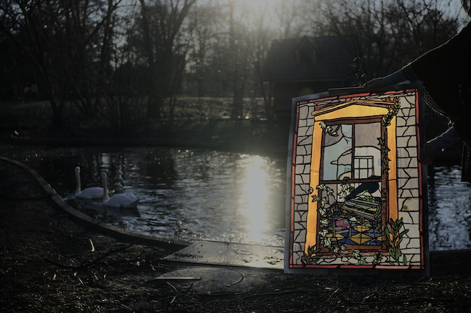 Here is a photograph in the  park of one of the Stained Glass made out of plastic piece that we are offering to our $1000 and up donor.