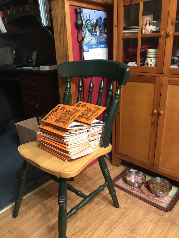 Stack of Zines in Chris' Mom's Kitchen (the original home of 9th Level Games)