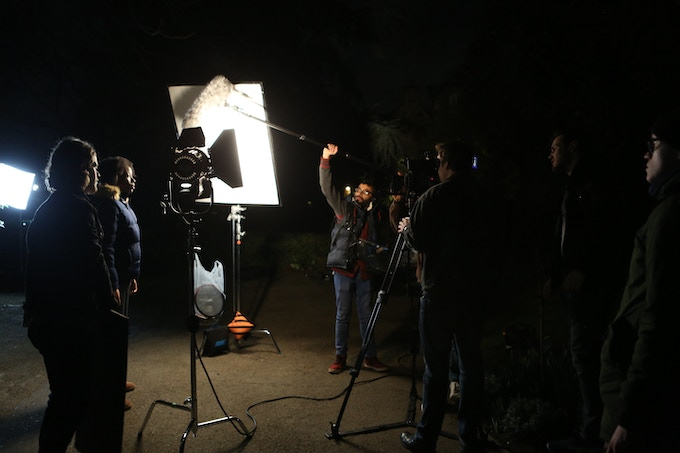 Behind the scenes at a night shoot of production