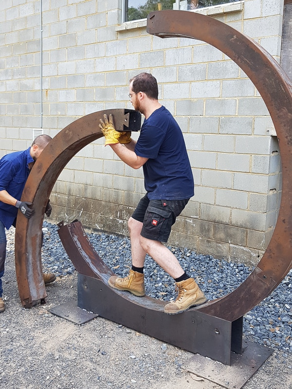 """Thomas (left) and Laurent (right) working on """"Un Ring"""" which was part of Mullumbimby Sculpture Festival 2018"""