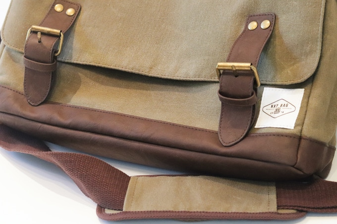 12oz Waxed canvas with heavy duty stitching throughout, Leather base and handle and closing straps.