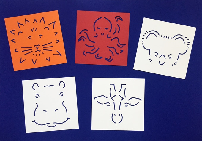 Prototypes of the 5 cards with colored paper and shiny coated paper