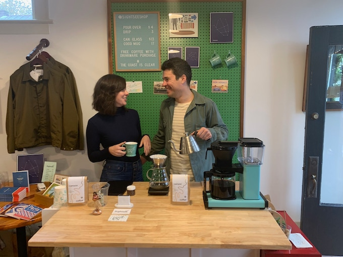 Allyson and Joel with our mobile coffee counter at a pop-up in 2018.