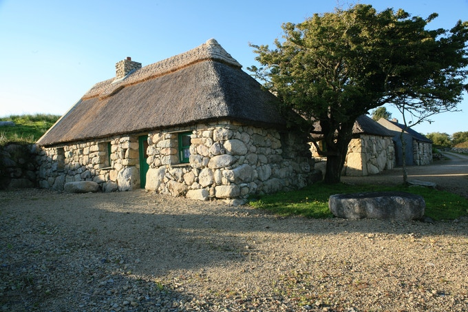 The restored thatched stone cottages in 'An Baile Íochtar', Cnoc Suain