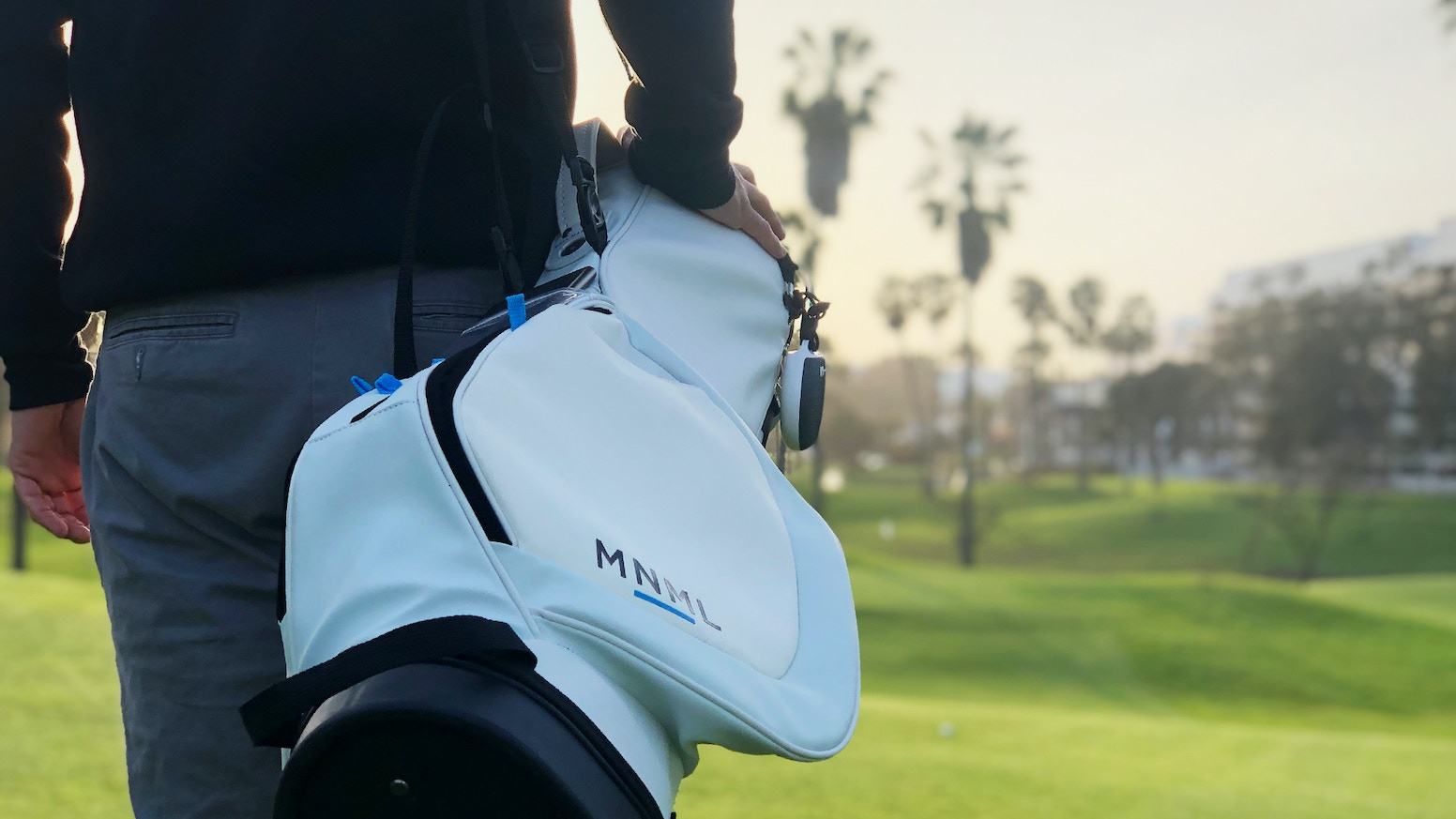 Minimalistic golf bag with patented system that integrates technology such as smart phone, bluetooth speaker, and solar battery pack.