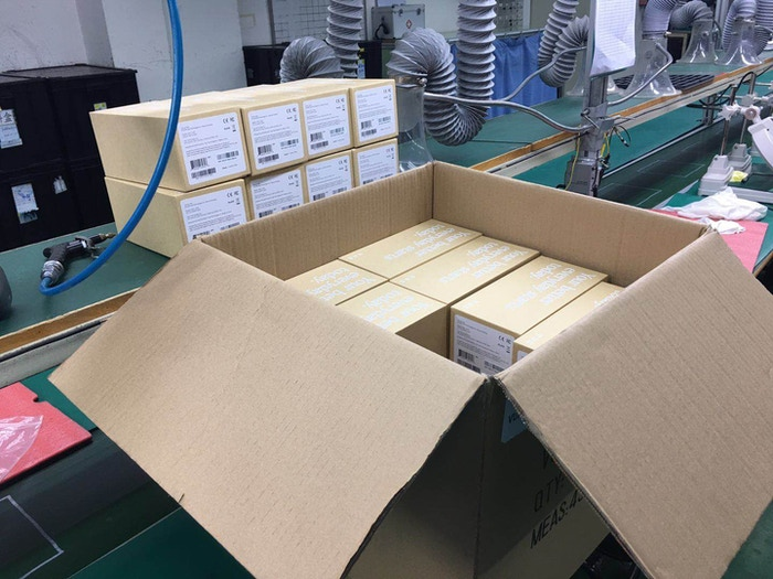 Packaged and labeled units waiting for the protective film application