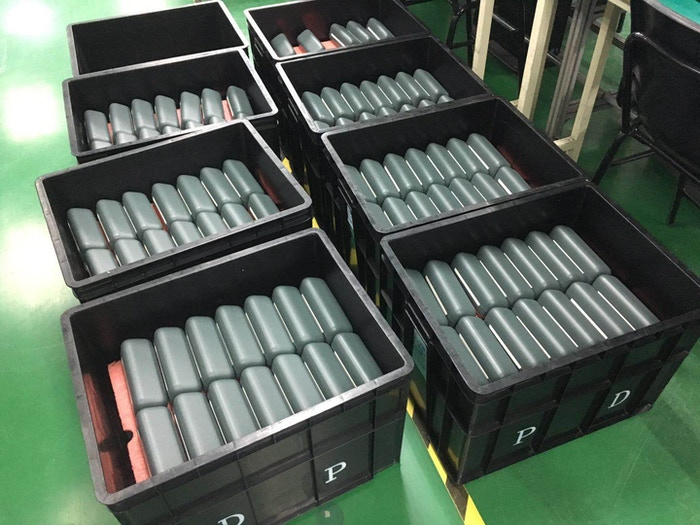 Boxes filled with finished charging case assemblies