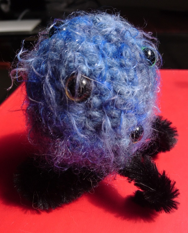 Example of a Crocheted Creature. Not all of its eyes and legs are displayed here. Not all Crocheted Creatures will look like this.
