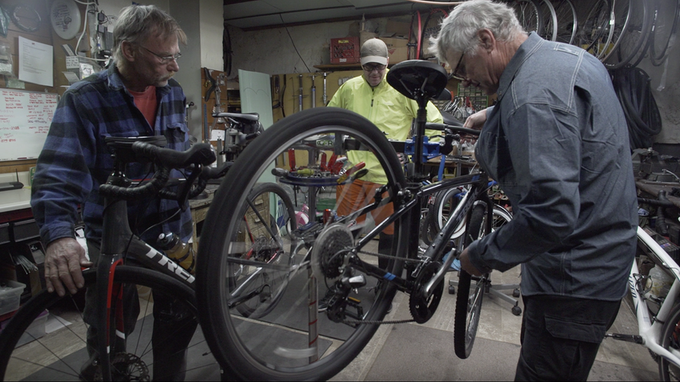 Dave with owner Rob Reed and staff at The Quick Service Bicycle Shop in Bridgeport, OH, getting repairs on his bicycle