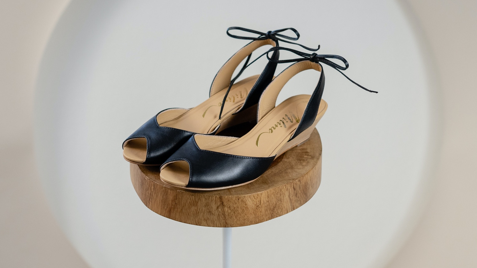 sustainably made leather and wood wedge sandal designed to be universally flattering, versatile and comfortable