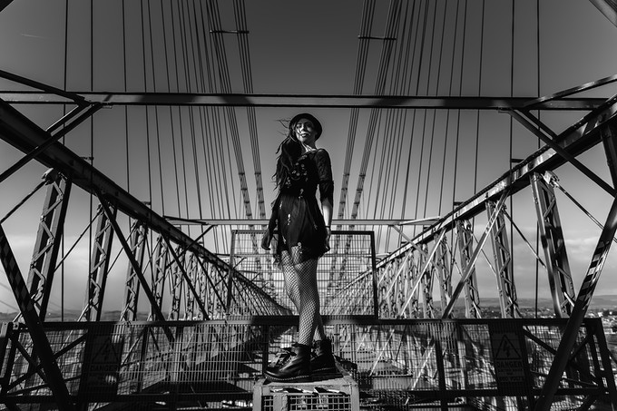 Georgie (Face of Newport Rising Festival and City Riots Ravens - Female Roller Derby Player) on the top of the Transporter Bridge